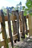 Rustic wooden fence. Charming rough hewn wooden fence in the countryside. The weathered and dilapidated wood has a lovely texture Royalty Free Stock Images