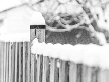 Rustic wooden fence post and country fence covered in deep snow. Rustic wooden fence post and country fence covered in deep freshly fallen snow Stock Photo
