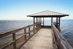 Rustic Wooden Fishing and Swimming Pier royalty free stock image
