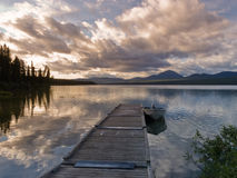 Rustic wooden float dock jetty boat tranquil lake Stock Photography