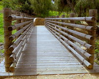 A rustic Wooden Footbridge. Crossing a gentle flowing stream royalty free stock photos