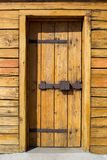 Rustic wooden fortress door with old iron latch Royalty Free Stock Photography