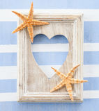 Rustic wooden frame on stripes Stock Images