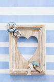 Rustic wooden frame on stripes Stock Photography