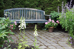 Rustic wooden garden bench Royalty Free Stock Photo
