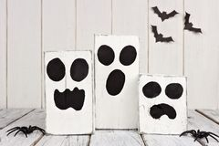 Rustic wooden Halloween ghosts Stock Photos