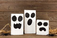 Rustic wooden Halloween ghosts Royalty Free Stock Photo