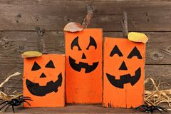 Rustic wooden Halloween Jack o Lanterns Stock Photo