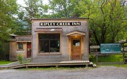 A rustic wooden inn beside a creek in the yukon territories stock image