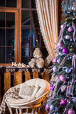 Rustic wooden living room with decorated Christmas tree Stock Photos