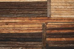 Rustic wooden log wall. Variable rustic wooden log wall background texture royalty free stock image