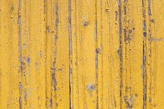 Rustic wooden old flaked  yellow painted texture of planked wall pattern stock photography
