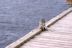 Rustic wooden pier and water Royalty Free Stock Photos