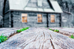 Rustic wooden planks with  old wooden house background Royalty Free Stock Images