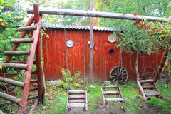 Rustic wooden playground. Traditional and rustic wooden playground n the courtyard Royalty Free Stock Photos