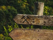 Rustic wooden sign with crossed hammers and copyspace royalty free stock photo