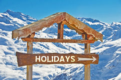 Rustic wooden sign direction holidays Stock Photos