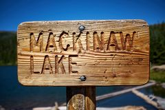 Rustic wooden signpost for Mackinaw Lake royalty free stock image
