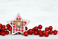 Rustic wooden star as a Christmas ornament Stock Photos