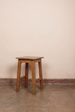 Rustic wooden stool Royalty Free Stock Image