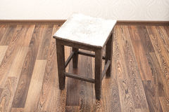 Rustic wooden stool in room interior Royalty Free Stock Image