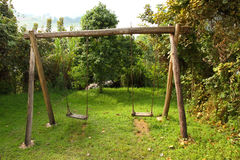 Rustic Wooden Swing Set Stock Image
