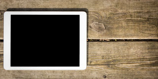Rustic wooden table with digital tablet. View from above Stock Photography