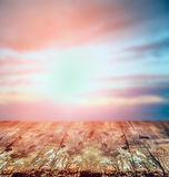 Rustic wooden table over sunset sky, nature background. Royalty Free Stock Photo