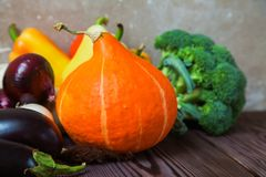 Rustic wooden table pumpkin eggplant broccoli pepper Royalty Free Stock Photography