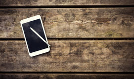 Rustic wooden table with smartphone. View from above Stock Images