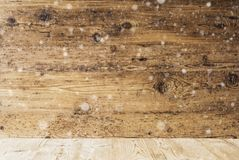 Rustic Wooden Texture With Snowflakes, Background With Copy Space. Rustic Wooden Texture With Copy Space For Advertisement. Natural Wood Background With royalty free stock photo