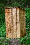 Rustic wooden toilet in the forest Stock Photography