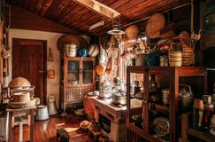 Rustic wooden vintage kitchen in country house interior decorati Stock Photos
