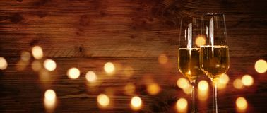 Rustic wooden wall with champagne and festive bokeh stock photography