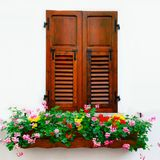 Rustic wooden window with floral decoration,  on white b Royalty Free Stock Images