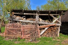 Rustic woodpile with harvested firewood outdoors Royalty Free Stock Photos