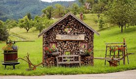 Rustic woodshed with welcome sign Stock Image