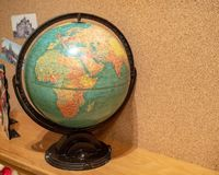Rustic world globe displaying Africa and Europe in a child`s room