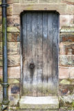 Rustic worn Medieval Door Stock Photography