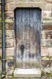 Rustic worn Medieval Door Stock Photography