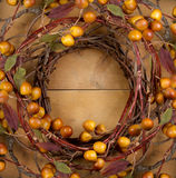 A rustic wreath on a wooden background Royalty Free Stock Photography