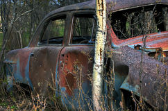 Rustic Wreck Car. Bullet holes, rust and dents on an old vehicle Stock Photography