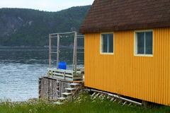 Rustic yellow cabin Stock Photo