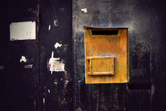 Rustic yellow wooden mailbox Stock Photos