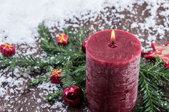 Rustical Candles in the snow Royalty Free Stock Photography