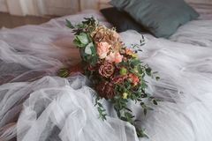 Wedding bouquet on the bed Stock Image