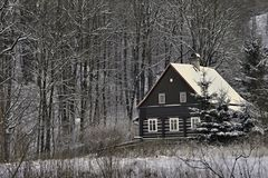 Rustically European log building in winter. Stock Photo
