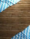 Rustieke achtergrond voor Oktoberfest met Beierse witte en blauwe stof op houten - het 3D teruggeven Stock Afbeeldingen