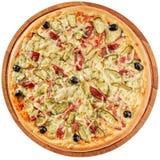 Rustieke pizza met ham en groenten in het zuur Royalty-vrije Stock Foto