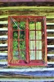 Rustikale alte Blockhausfenster gelegen in Childwold, New York, Vereinigte Staaten Stockfoto